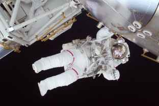 person in white astronaut suit